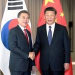 文在寅氏(左)習近平氏