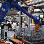 MUJINブース内の株式会社三明の製品。金属加工業の現場で製品選別を行う