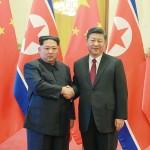習近平氏(右)と金正恩