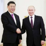 習近平国家主席(左)とプーチン大統領