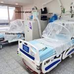 ベッドの患者の上半身を覆う透明カバーを開発