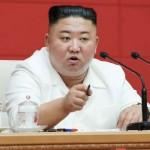 19日、平壌で、朝鮮労働党中央委員会総会に出席する金正恩党委員長(朝鮮通信・時事)