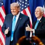 24日、米南部ノースカロライナ州シャーロットで開かれた共和党全国大会で、登壇したトランプ大統領(左)とペンス副大統領(AFP時事)