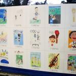 射撃の行われる朝霞市で展示された、小学生たちが大会をテーマに描いたイラスト=23日、埼玉県朝霞市
