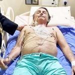 14日、ブラジリアにある病院のベッド上のボルソナロ大統領=大統領のツイッターより(AFP時事)