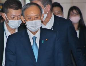 6月9日、党首討論に臨む菅首相(UPI)
