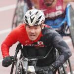 陸上男子100メートル(車いすT52)で銀メダルを獲得した大矢勇気選手=3日、国立競技場